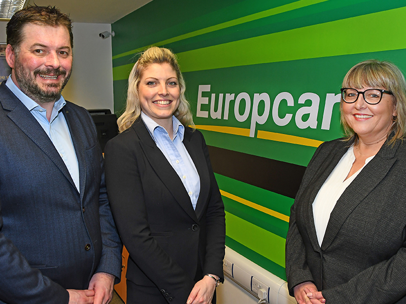 Autohorn team stood with Europcar sign
