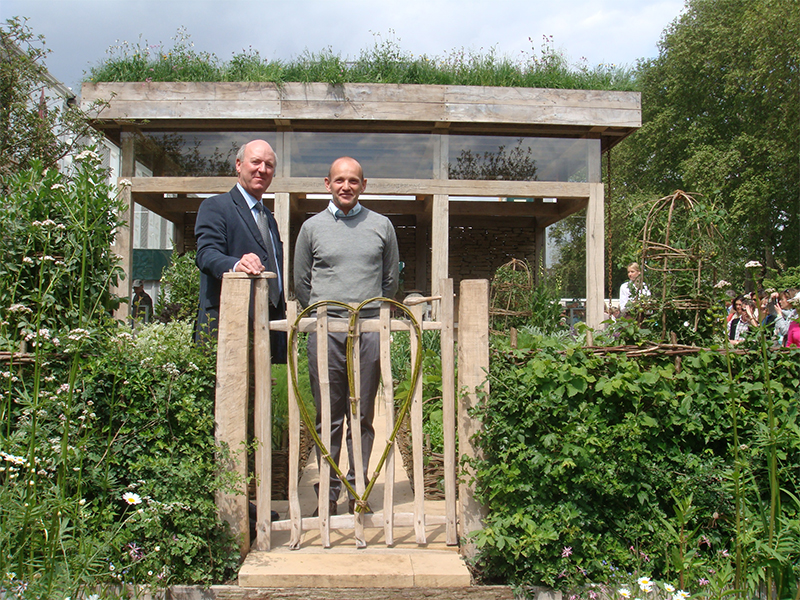 Lindum Turf Team stood in Chelsea Flower Show garden
