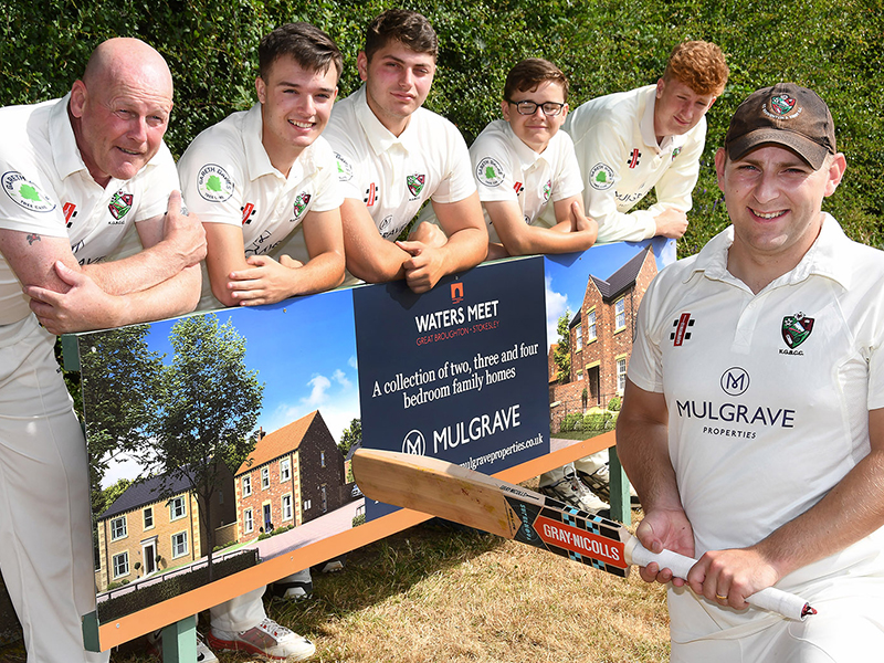 Great Broughton Cricket team stand with Mulgrave Properties signage