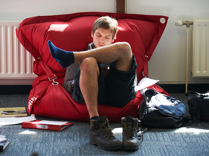 University of York student studying on beanbag in library