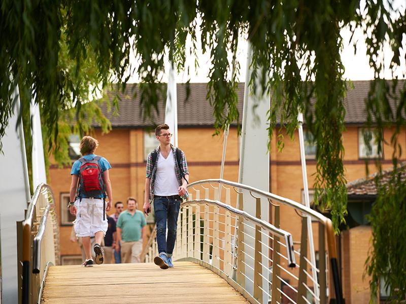Student walking across Wentworth Bridge