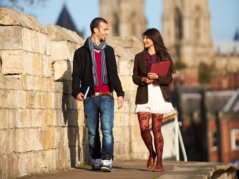Students walking on York walls