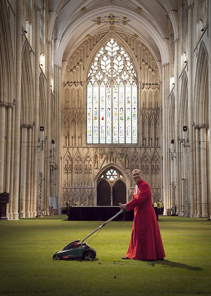 WowGrass Turf on Minster floor while priest mows lawn
