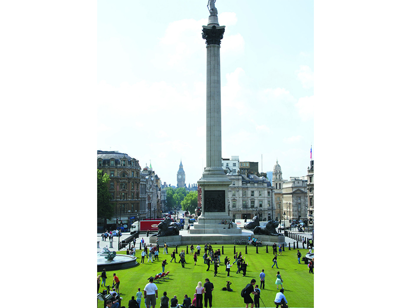 Trafalgar Square turfed with Big Ben in the background
