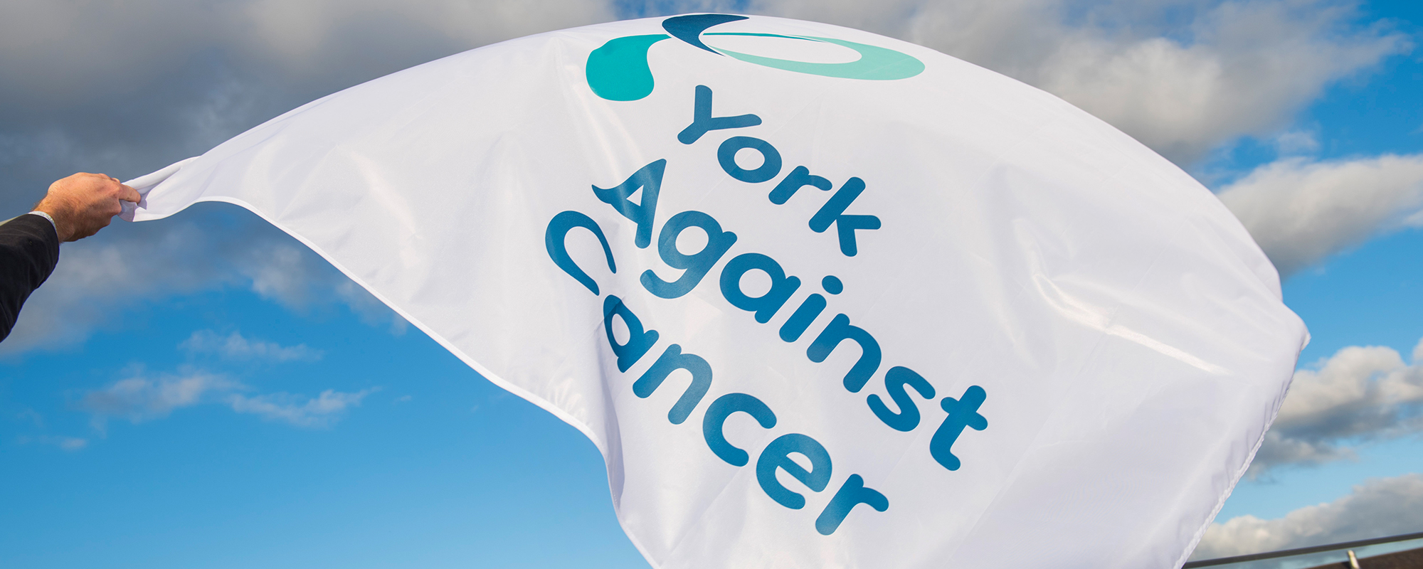 York Against Cancer flag waving in the air