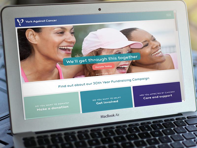 York Against Cancer website on laptop